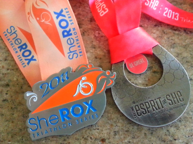 Medals from 2011 She Rox and 2013 Esprit de She triathlons
